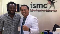 Indosport - Michael Essien dan dr.Andi