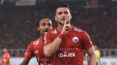 Indosport - Aksi selebrasi pemain Persija Jakarta, Marko Simic.