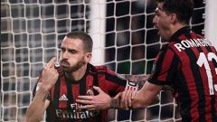 Indosport - Leonardo Bonucci saat melakukan selebrasi usai mencetak gol untuk Milan ke gawang Juventus.