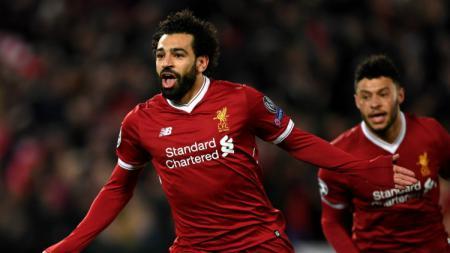 Selebrasi Mo Salah setelah cetak gol pertama. - INDOSPORT