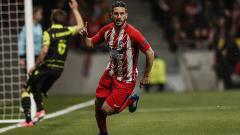 Indosport - Koke saat membuka keunggulan Atletico Madrid saat melawan Sporting Lisbon.