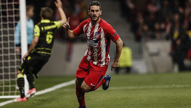 Koke saat membuka keunggulan Atletico Madrid saat melawan Sporting Lisbon. Copyright: Getty Image