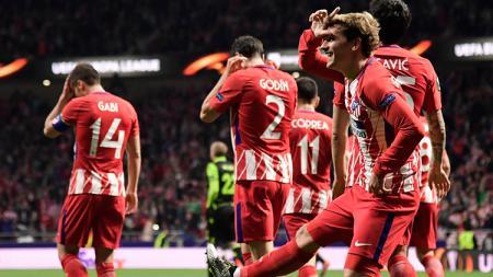 Antoine Griezmann berselebrasi usai mencetak gol ke gawang Sporting Lisbon. - INDOSPORT