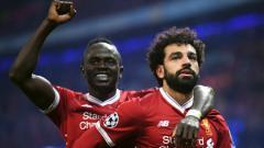 Indosport - Dua pemain Liverpool, Sadio Mane dan Mohamed Salah.