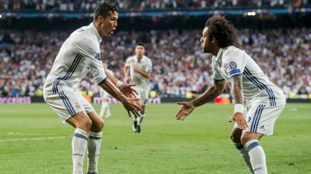 Ronaldo dan Marcelo berselebrasi pasca mengandaskan Bayern Munchen. - INDOSPORT