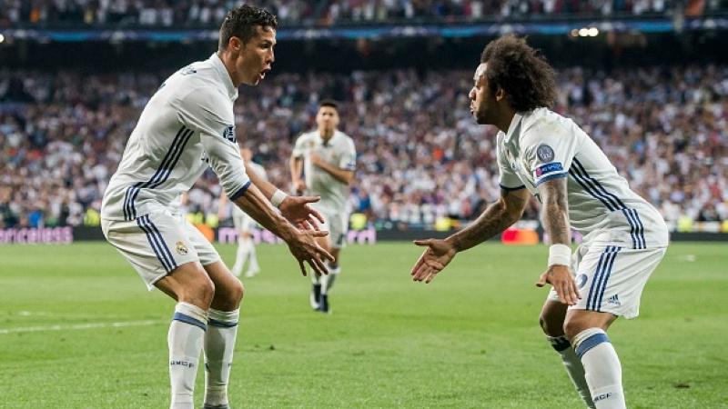 Ronaldo dan Marcelo berselebrasi pasca mengandaskan Bayern Munchen. Copyright: INDOSPORT