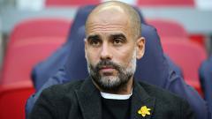 Indosport - Pep Guardiola, pelatih Man City.