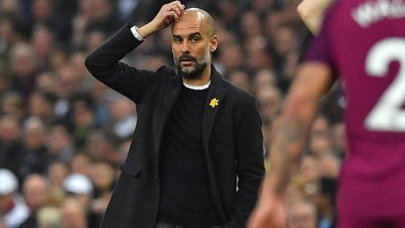 Pelatih klub Liga Inggris, Manchester City, Pep Guardiola, mendapat kritik dari legenda Arsenal, Paul Merson. - INDOSPORT