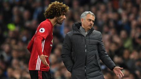 Marouane Fellaini dan Jose Mourinho - INDOSPORT
