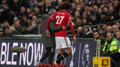 Indosport - Marouane Fellaini dan Jose Mourinho.