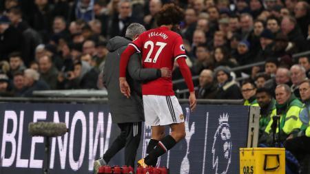 Marouane Fellaini dan Jose Mourinho. - INDOSPORT