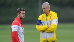 Indosport - Jack Wilshere dan Arsene Wenger.