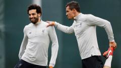 Indosport - Bintang Liverpool, Mohamed Salah, mungkin masih merindukan sosok sahabatnya, Dejan Lovren, yang kini sudah pindah ke Zenit.