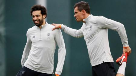 Dejan Lovren terus menjalin hubungan baik dengan bintang Liverpool, Mohamed Salah, meskipun mereka kini sudah tidak lagi satu tim. - INDOSPORT