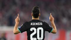 Indosport - Marco Asensio merayakan golnya ke gawang Bayern Munchen.