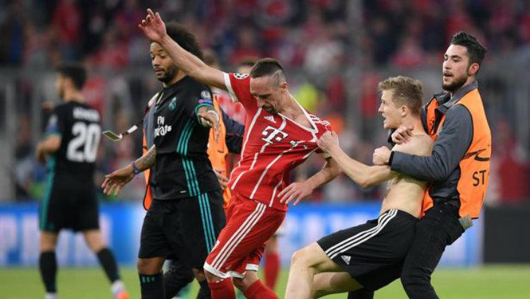 Suporter di laga Munchen vs Madrid. Copyright: Reuters