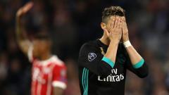 Indosport - Cristiano Ronaldo tampak kecewa akan performanya.