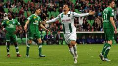 Indosport - Pemain FC Groningen melakukan selebrasi.
