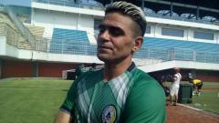 Indosport - Pemain PSS Sleman Cristian Gonzales.