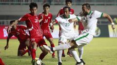 Indosport - Kemelut di gawang Korea Utara gagal dimanfaatk oleh Spaso.