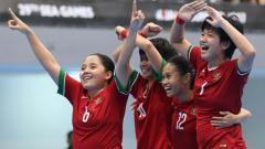 Indosport - Selebrasi Timnas Futsal Putri Indonesia.