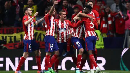 Skuat Atletico Madrid merayakan golnya ke gawang Arsenal beberapa waktu lalu. - INDOSPORT