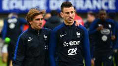 Indosport - Laurent Koscielny dan Antoine Griezmann