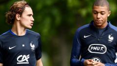 Indosport - Antoine Griezmann dan Kylian Mbappe.