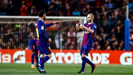 Andres Iniesta dan Lionel Messi. - INDOSPORT