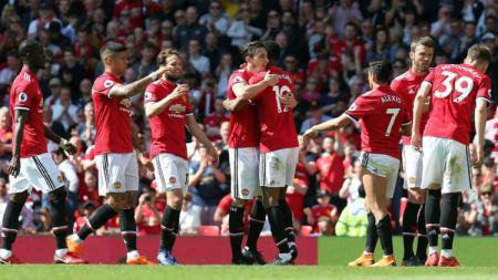 Para pemain Manchester United ketika melakukan selebrasi di lapangan. - INDOSPORT