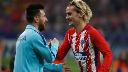 Dua bintang La Liga Spanyol: Lionel Messi (Barcelona) dan Antoine Griezmann (Atletico Madrid). - INDOSPORT