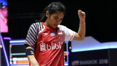Indosport - Gregoria Mariska Tunjung dalam laga Piala Uber 2018 melawan Malaysia.