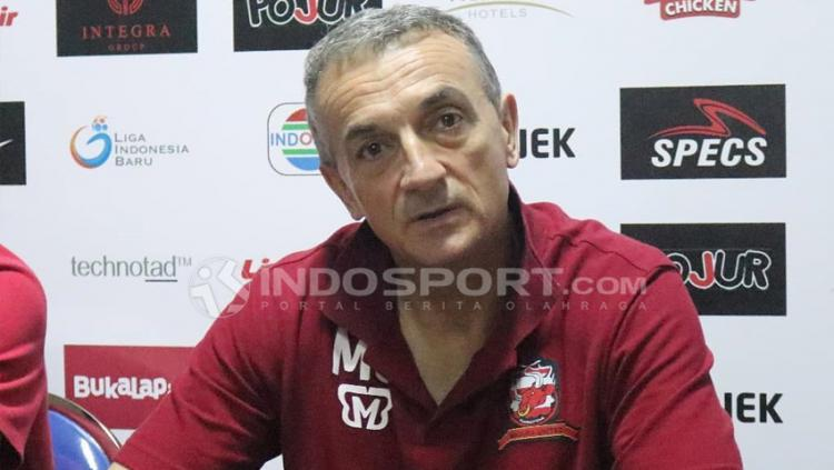 Milomir Seslija, Usai Kalah Lawan Persipura, Madura United Bertekad Ambil Poin Kandang. Copyright: Fitra Herdian/Indosport.com