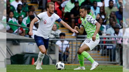 Harry Kane (kiri), William Troost Ekong (kanan). - INDOSPORT