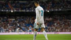 Indosport - Cristiano Ronaldo pergi meninggalkan lapangan.