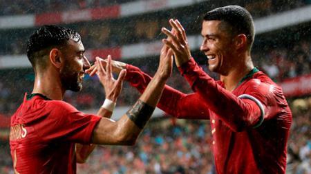 Cristiano Ronaldo lakukan selebrasi dalam laga Timnas Portugal pra Piala Dunia 2018. - INDOSPORT