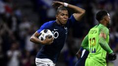 Indosport - Kylian Mbappe merayakan golnya untuk Timnas Prancis saat menghadapi Amerika Serikat.