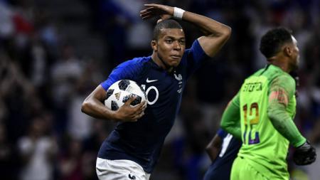 Kylian Mbappe merayakan golnya untuk Timnas Prancis saat menghadapi Amerika Serikat. - INDOSPORT