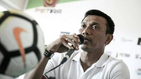 Pelatih Bali United Widodo Cahyono Putro di konferensi pers. - INDOSPORT