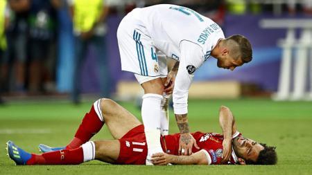 Jelang laga Liga Champions antara Real Madrid lawan Liverpool, Mohamed Salah dianggap masih membawa dendam kesumat ke Sergio Ramos. - INDOSPORT