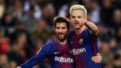 Indosport - Lionel Messi dan Ivan Rakitic di Barcelona.