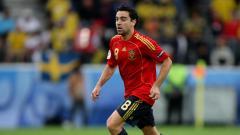 Indosport - Xavi Hernandez saat masih mengenakan jersey timnas Spanyol.