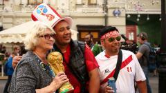 Indosport - Fans Timnas Peru tiba di Rusia untuk menonton Piala Dunia 2018.