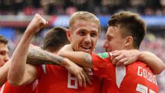 Indosport - Selebrasi para pemain Rusia.