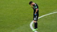 Indosport - Lionel Messi usai laga Grup D Piala Dunia 2018 antara Argentina vs Islandia yang berakhir imbang, Sabtu (16/06/18).