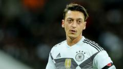 Indosport - Mesut Ozil saat mengenakan seragam Timnas Jerman.