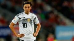 Indosport - Mesut Ozil dalam laga perdana Grup F, Jerman vs Meksiko, Minggu (17/06/18).