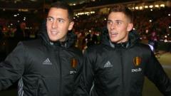 Indosport - Eden Hazard dan Thorgan Hazard saat bersama-sama di skuat Timnas Belgia untuk Piala Dunia 2018.