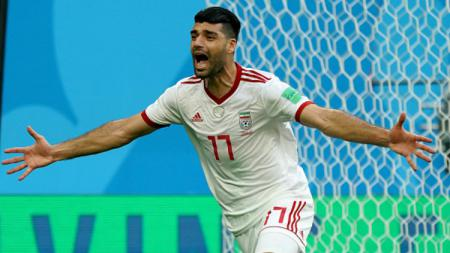 Mehdi Taremi (Iran) merayakan gol yang dicetaknya ke gawang Maroko di laga Piala Dunia 2018. - INDOSPORT
