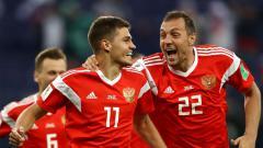Indosport - Selebrasi pemain Rusia usai membobol gawang Mesir di Piala Dunia 2018.